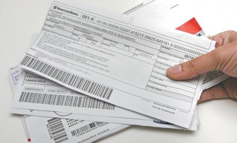 Serasa faz ação para quitar dívidas por R$ 100